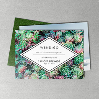 Photo of two mini business cards with a flourish design