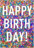 "A birthday card design with a background made of sprinkles. The message ""HAPPY BIRTH DAY"" is featured prominantly in white."