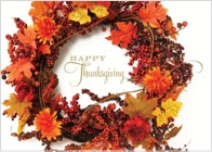 "A Thanksgiving greeting card design featuring a fall-colored wreath on a white background with a message that reads ""Happy Thanksgiving"""