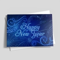 A 2017 Happy New Year greeting card with festive swirl and fireworks designs in a sophisticated blue on blue color scheme.