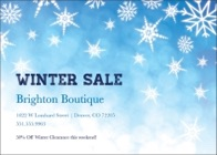 A promotional postcard with a blue background and multiple white snowflakes. The message reads Winter Sale.