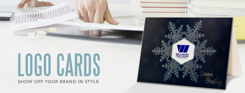 "A ""Season's Greetings"" greeting card on a desk next to the phrase ""Logo Cards: Show Off Your Brand in Style"