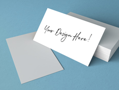 "A stack of business cards with a message that reads ""Your design here!"""