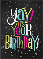 The front of this birthday card features a colorful message of 'Yay! It's Your Birthday!' with lively letters and a birthday candle accent. The message is presented against a black background with silver confetti.