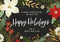 On the front of this holiday card, a floral border with white and red flowers, green leaves, and gold accents is featured around a message that reads 'In Warm Appreciation, We Wish You Happy Holidays and a Happy New Year' in white. The back of the card is gold.