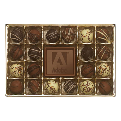 Comes with an assortment of 20 filled truffles professionally selected for your enjoyment. Truffles are placed around a customizable solid milk chocolate centerpiece featured in a gold box with matching ribbon.