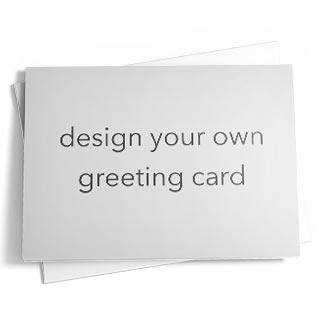 A blank greeting card that reads 'design your own greeting card' on top of a matching envelope.