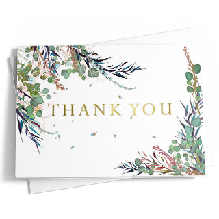'Thank You' is written in a midnight blue script font against a brushed, multi-tone, gray background. A spattering of rose gold foil creates a unique and elegant look on the front of the card. More drops of rose gold are seen throughout the interior of the card as well. The background on the opposing side mirrors the front.
