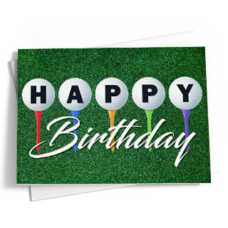 The front of this golf-themed birthday card features a short green grass background with a colorful row of golf tees. Red, blue, yellow, green, and purple golf tees hold up white golf balls with black letters that spell 'Happy.' The word 'Birthday' is written underneath in a stylish white script. The back of the card is blue.