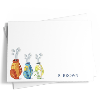 This golf-themed personalized stationery features three golf bags in different colors on the front. Colors used include tan, yellow, green, blue, and white. The back of the stationery is light blue. Add text, choose from different paper types, and standard or junior sizes.